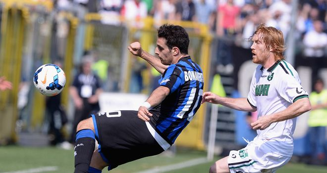 Giacomo Bonaventura finds a way to clear the ball