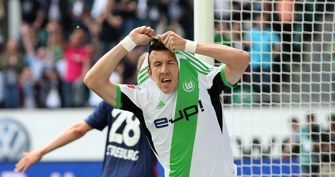 Ivan Perisic celebrates his second goal for Wolfsburg