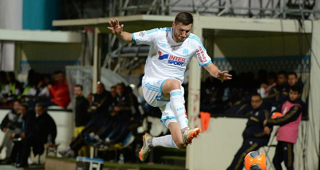 Andre-Pierre Gignac jumps over Idrissa Gueye