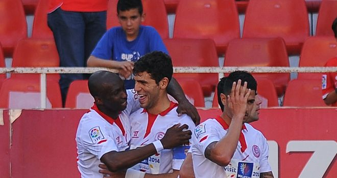 Sevilla's Mbia (left) enjoys celebrating with teammates