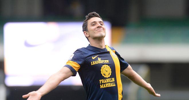 Marquinho celebrates after scoring for Verona on Sunday