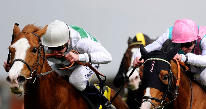 Cubanita (left) gets the better of Noble Mission at Newbury