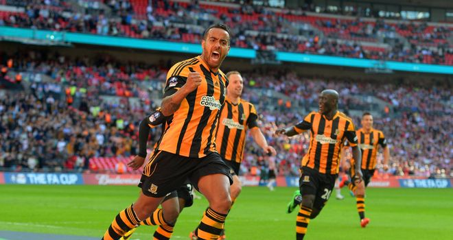 Tom Huddlestone: Celebrates scoring Hull's third goal