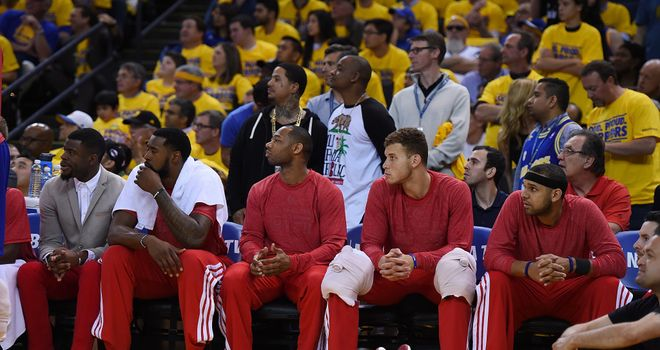 Los Angeles Clippers players wear their warm-up tops inside out