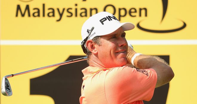 Lee Westwood of England in action during round one of the 2014  Maybank Malaysian Open