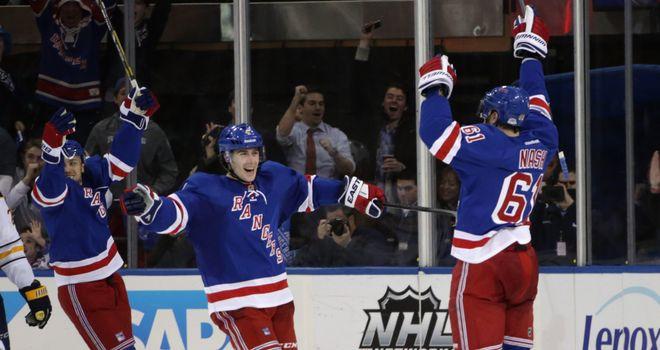Rick Nash (r) celebrates his winning goal for the New York Rangers