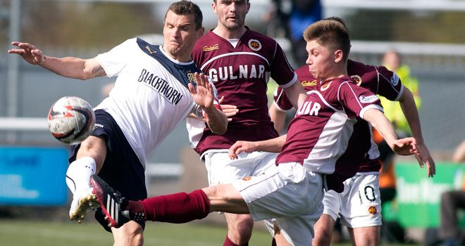 Rangers captain Lee McCulloch and Stenhousemuir's Brian Hodge battle for the ball