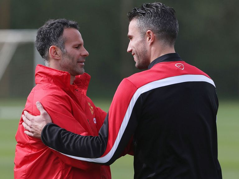Ryan Giggs talks with Robin van Persie on Friday