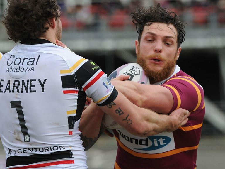 Full-back Scott Grix celebrated his new contract with the opening try for Huddersfield