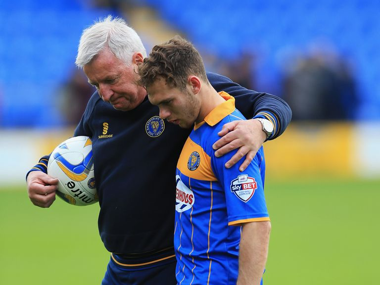 Jon Taylor of Shrewsbury is consoled after the costly defeat
