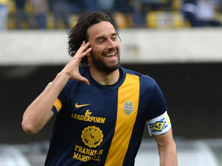 Luca Toni celebrates after scoring for Verona