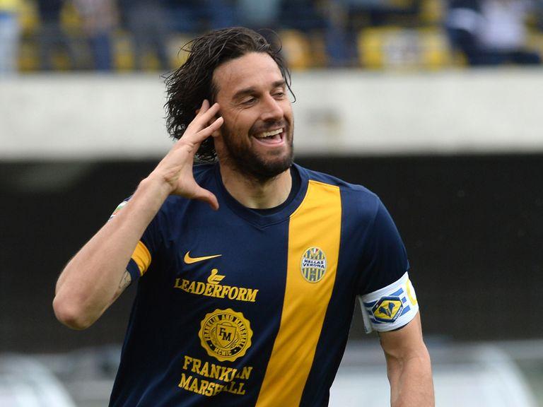 Luca Toni celebrates after scoring for Verona