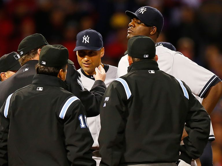 Home plate umpire Gerry Davis throws out Michael Pineda