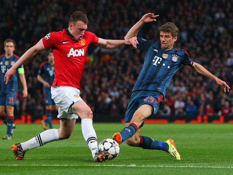 Phil Jones is tackled by Thomas Muller