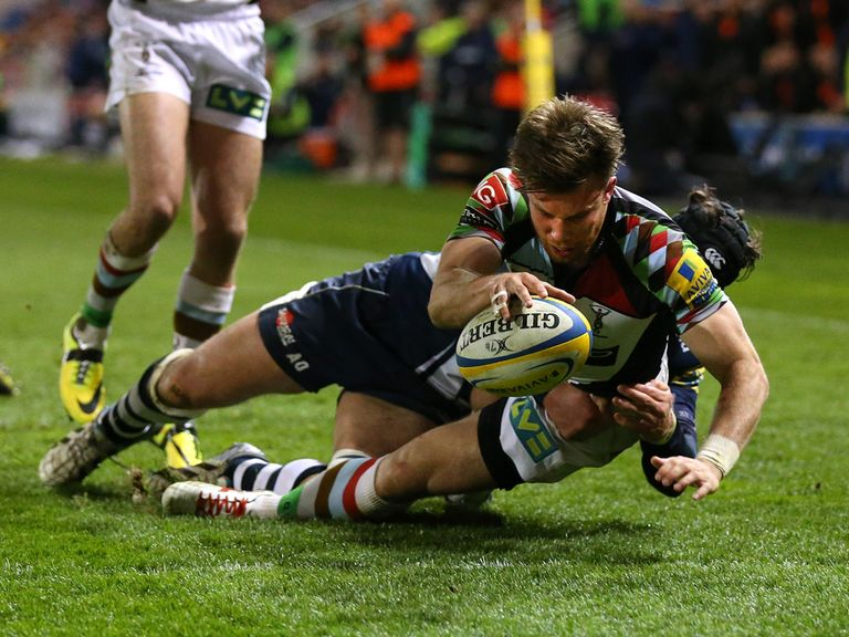 Sam Smith scrambles over for a try for Harlequins