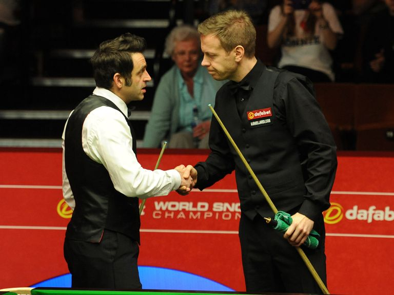 Ronnie O'Sullivan shakes hands with Robin Hull after defeating him in Sheffield
