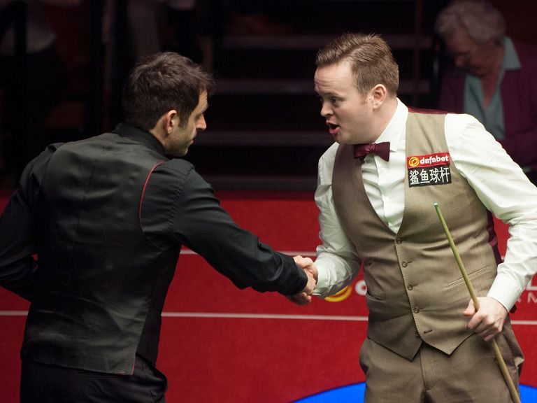 Ronnie O'Sullivan shakes hands with Shaun Murphy after his victory on Wednesday