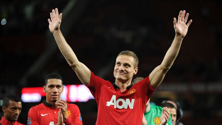 Vidic waves to Manchester United supporters after his last game at Old Trafford