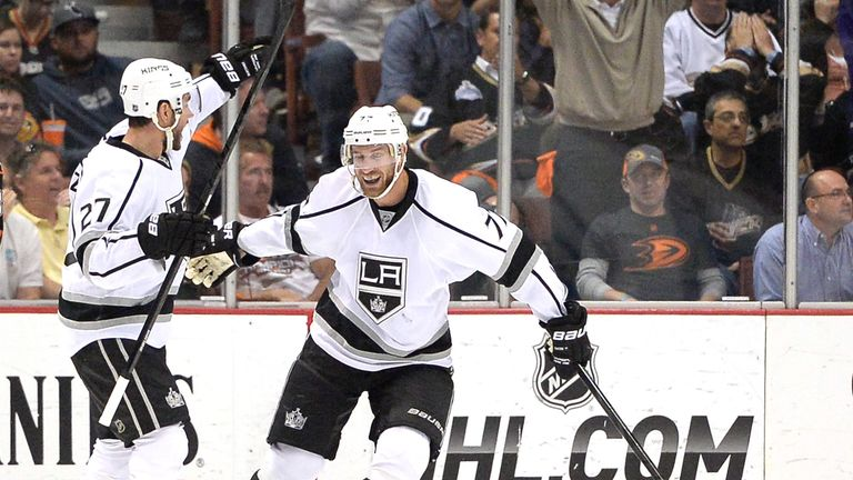 Alec Martinez celebrates his goal for the Kings with Jeff Carter (r)