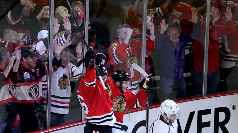 Michal Handzus and Patrick Kane celebrate beating the LA Kings