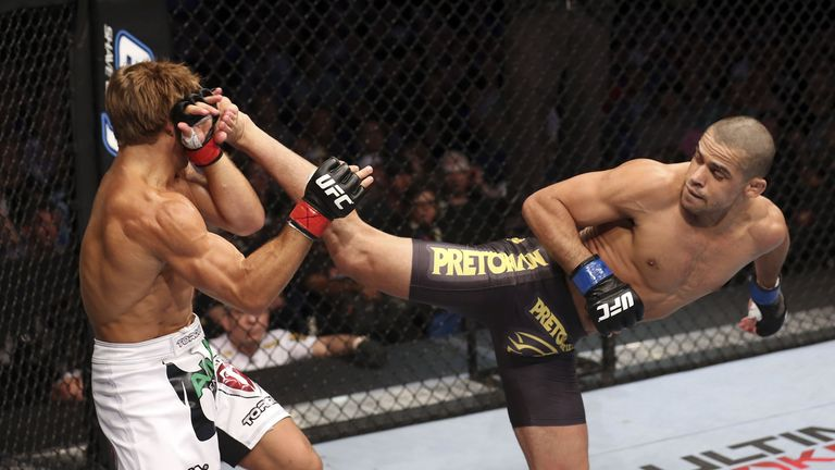 Renan Barao kicking Urijah Faber in a previous title defence