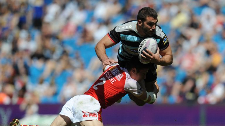 London Broncos' Maxime Herold is tackled by Catalan Dragons' Morgan Escare