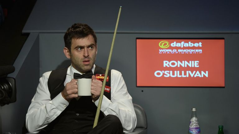 Ronnie O'Sullivan: Defending world champion enjoys a warm drink during first session of his semi-final