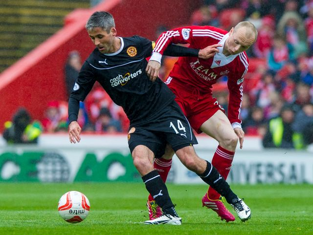 Keith Lasley is kept in check by Willo Flood
