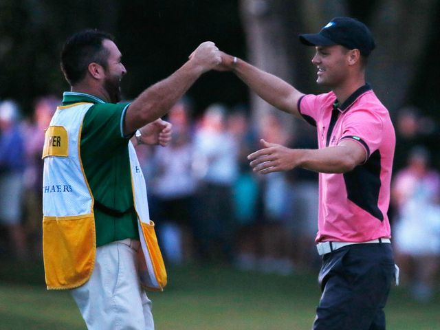 Martin Kaymer celebrates with caddie Craig Connelly