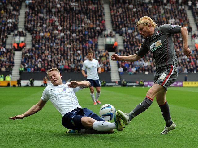 Tom Clarke tackles Ben Pringle