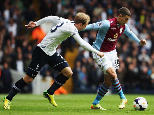 Matt Lowton gets away from Christian Eriksen