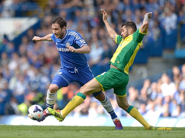Frank Lampard and Bradley Johnson battle for the ball
