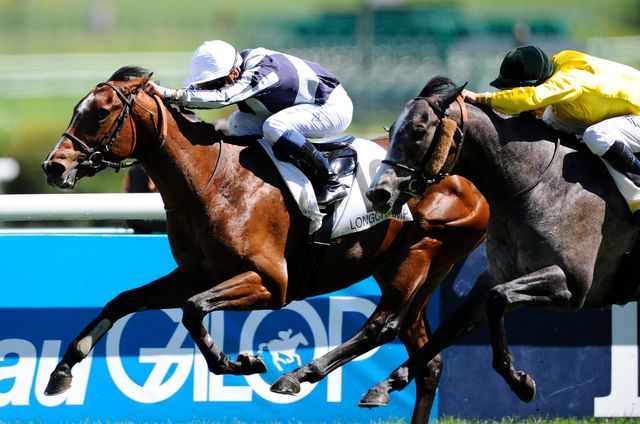 Stephane Pasquier and Karakontie win the Poule D'Essai Des Poulains at Longchamp.