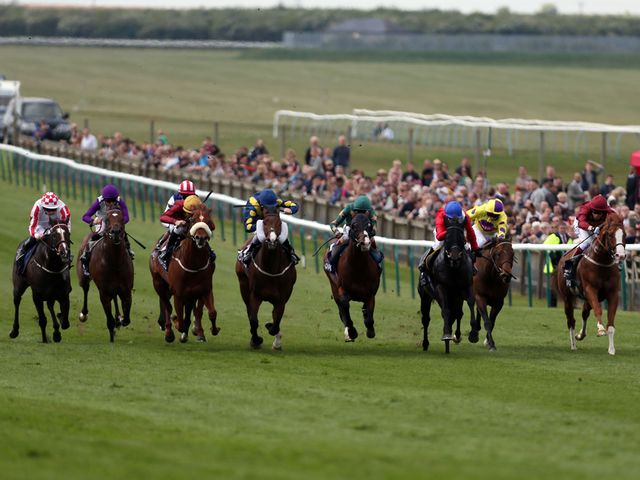 Sole Power (left) comes widest of all to win the Palace House Stakes under Moore.
