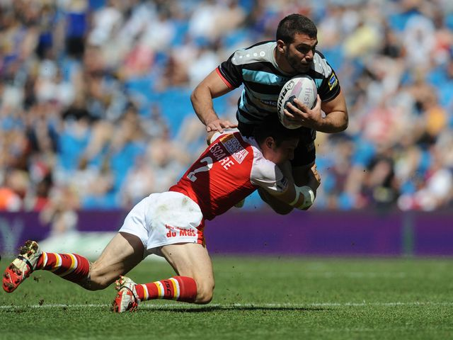 London's Maxime Herold is tackled by Catalan Dragons' Morgan Escare