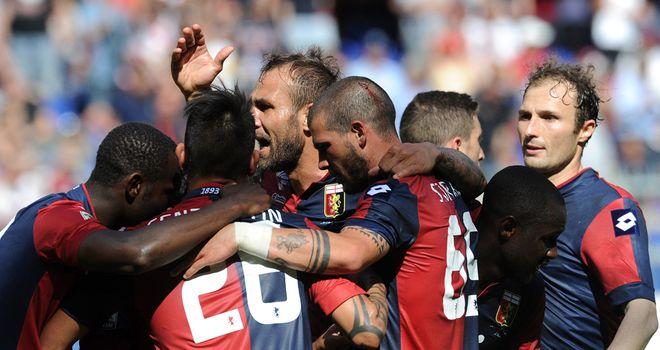 Genoa players celebrate after the only goal of the game