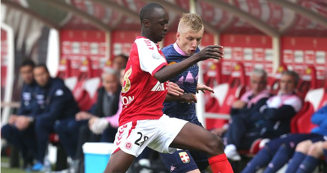 Reims' Antoine Conte (left) vies with Evian's Daniel Wass