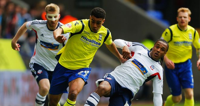 Neil Danns (right): Bagged a brace for Bolton