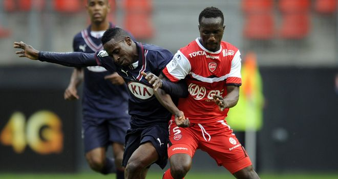 Valenciennes' Benjamin Angoua (right) challenges Andre Biyogo Poko