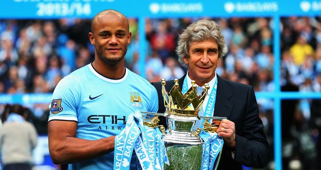 Vincent Kompany and Manuel Pellegrini: To celebrate with City fans in Manchester on Monday