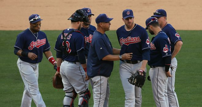 Cleveland Indians starting pitcher Zach McAllister (third from right) is taken out of the game