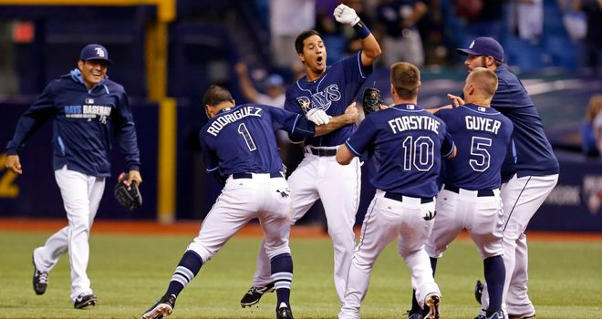 Winning joy: Tampa Bay Rays' Cole Figueroa of the congratulated by team-mates