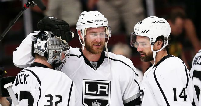 Jonathan Quick, Jeff Carter and Justin Williams celebrate the win over the Blackhawks