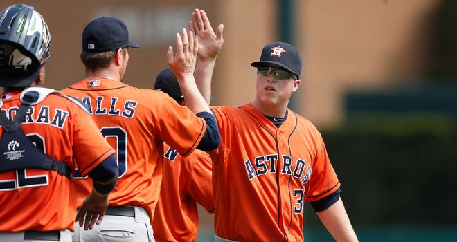 Matt Dominguez celebrates with his Houston Astros team-mates