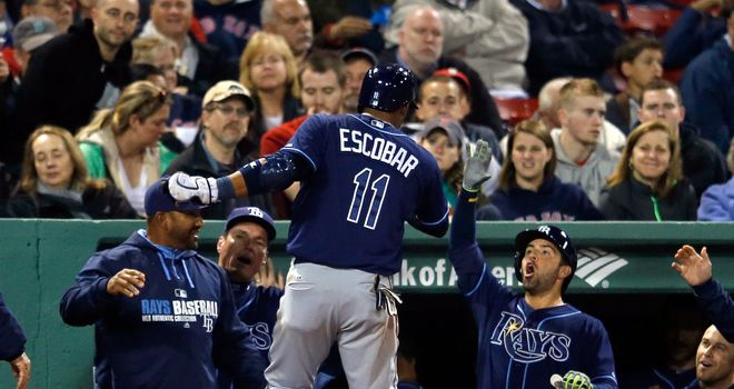 Yunel Escobar celebrates after hitting a home run in the ninth inning against the Boston Red Sox