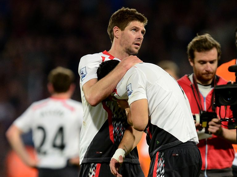Steven Gerrard consoles a dejected Luis Suarez at full-time