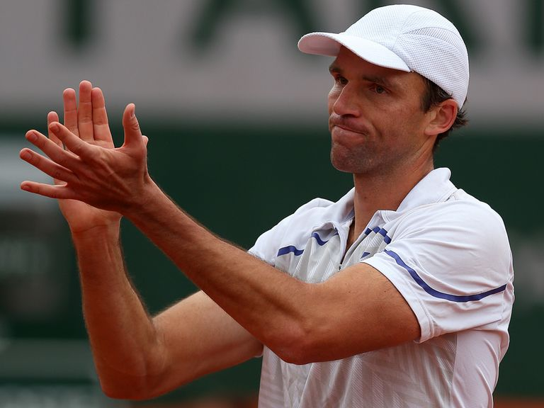 Ivo Karlovic celebrates his win over Dimitrov
