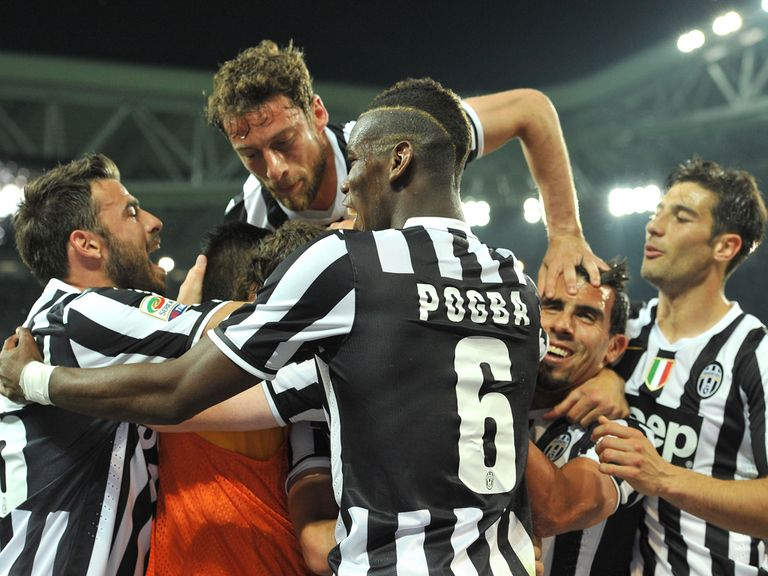 Juventus players celebrate the only goal of the game