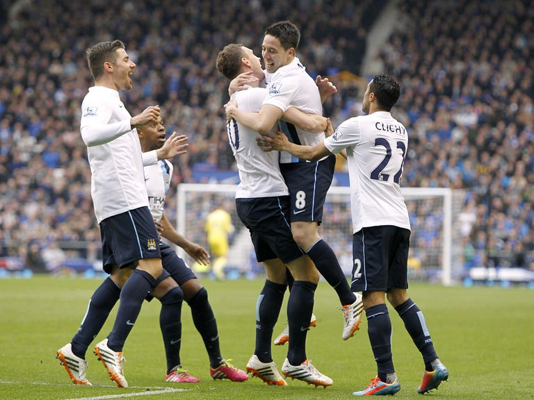 Manchester City players celebrate at Goodison