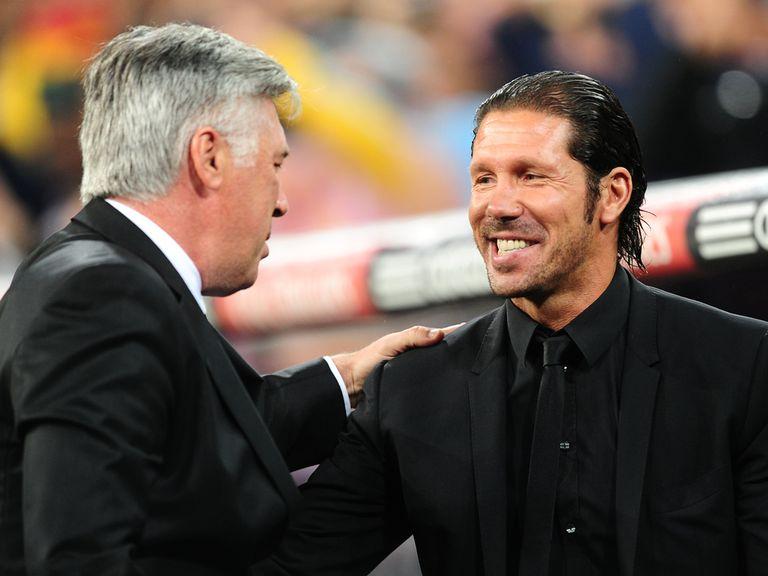 Carlo Ancelotti (left) greets Diego Simeone